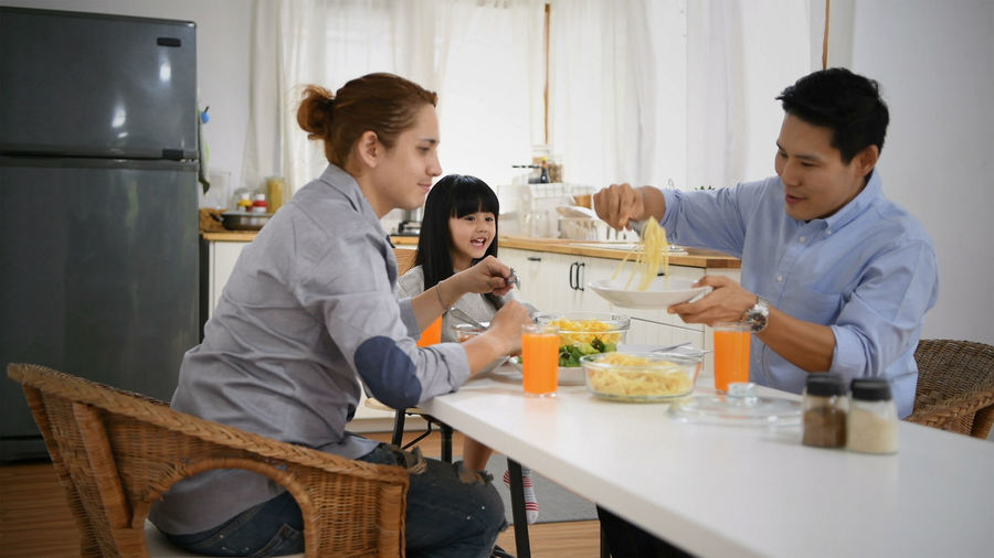 Group Of People Women Men Togetherness Food And Drink Food Lifestyles Adult Family Child Indoors  Standing Table Parent Mid Adult Females Males  Holding Mother Young Adult Daughter Preparation  Preparing Food Positive Emotion Son