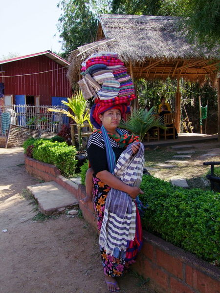 Shan Woman Sellin Clothes Composition Ethnic Beauty Ethnic People Ethnic Photography Ethnic Portrait Ethnic Pride Full Frame Full Length Full Length Portrait Inle Lake Kakku Looking At Camera Making A Living Myanmar Only One Woman Outdoor Photography Selling Shan State Shan Woman Smiling Sunlight And Shadows Trader Traditional Clothing Woman Portrait