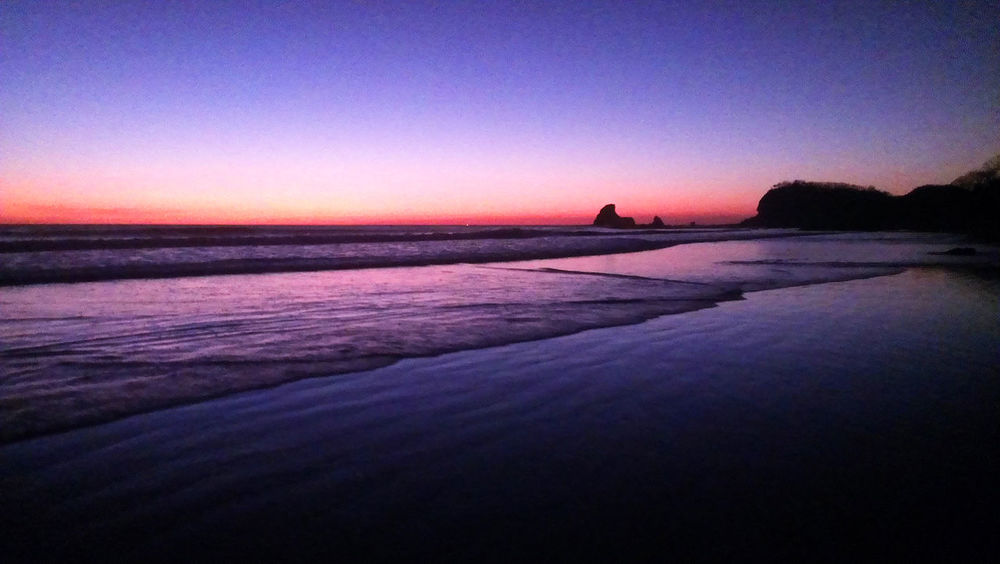 deep red sunset at Playa Maderas, Nicaragua Atmosphere Beach Beach Life Beach Photography Blue Nicaragua Ocean Playa Maderas Red Red Sunset Refelctions Sea Sun Reflection Sunset Tranquil Scene Tranquility Waves