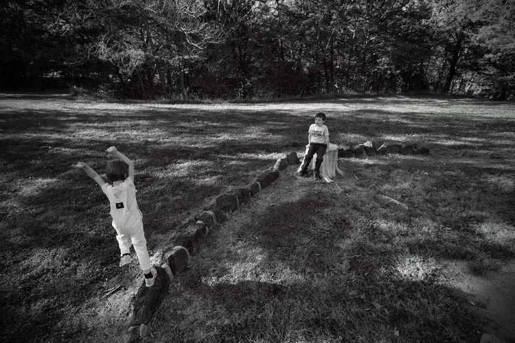 Siblings playing at park