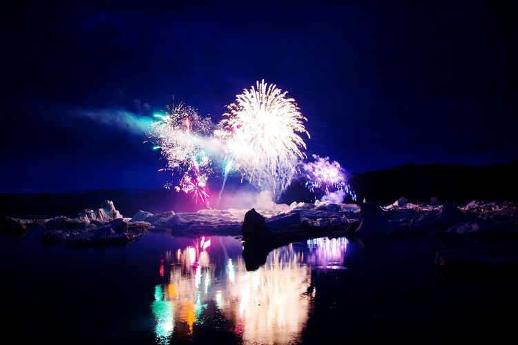Night Celebration Firework Display Firework - Man Made Object Exploding Arts Culture And Entertainment Illuminated Multi Colored Sky Reflection Event Celebration Event Low Angle View Water Lake Iceland Iceberg - Ice Formation Ice Shades Of Winter Landscape Frozen EyeEm Nature Lover Winter EyeEm Best Shots EyeEm Selects