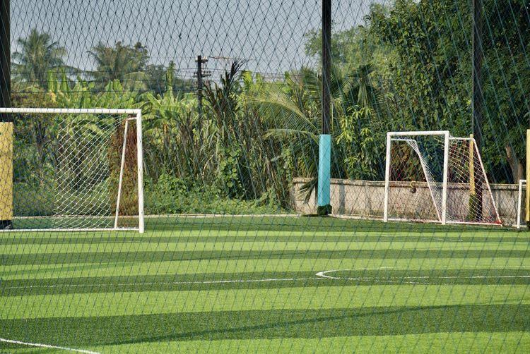 Soccer field seen through net