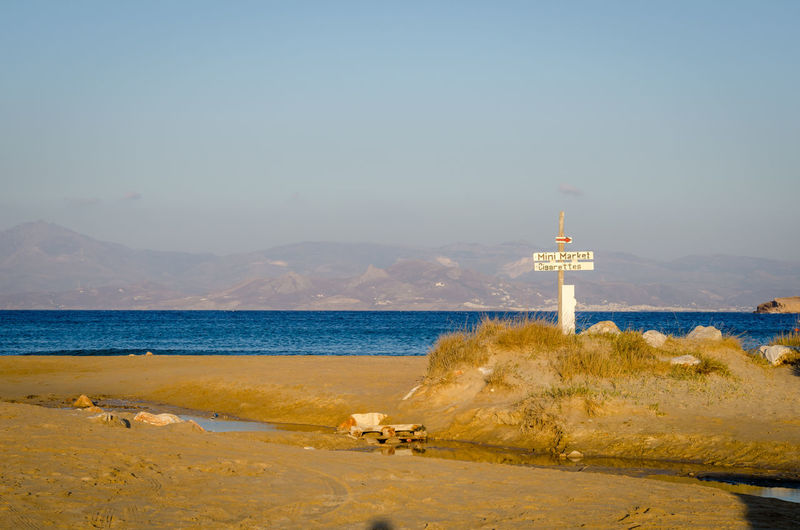 Santa Maria Paros Santa Maria Sign Signage The Week On EyeEm Beach Greece Guidance Horizon Over Water Nature No People Outdoors Scenics Sea Sky Travel Destinations Vacations Water