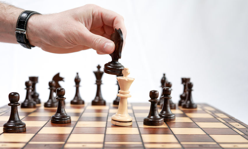Low angle view of man relaxing on chess board