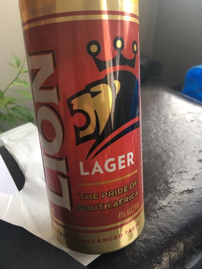Proud to be South African Text Communication Lion Lager The Pride Of South Africa Beer Lion Lion Crown Beer For Real Man Indoors  Close-up Drink
