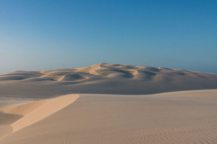 Exploring the beautiful dunes of Lencois Maranhenses. Arid Climate Blue Day Daylight Desert Desert Landscape Dry Horizon Over Land Landscape Minimalism No People Outdoors Pattern Sand Sand Dune Sandy Simple Sky Sun Sunset Tranquil Scene Tranquility Travel Travel Destinations Traveling The Great Outdoors - 2017 EyeEm Awards EyeEmNewHere Sommergefühle EyeEm Selects Lost In The Landscape Going Remote This Is Latin America The Great Outdoors - 2018 EyeEm Awards