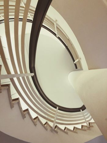 Spiral staircase EyeEm Selects Architecture Built Structure Steps And Staircases Spiral Staircase Staircase Railing Spiral Indoors  Low Angle View Architectural Feature Geometric Shape Shape Building
