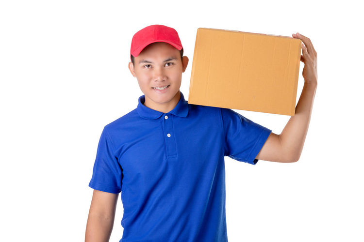 Portrait of a smiling young man against white background
