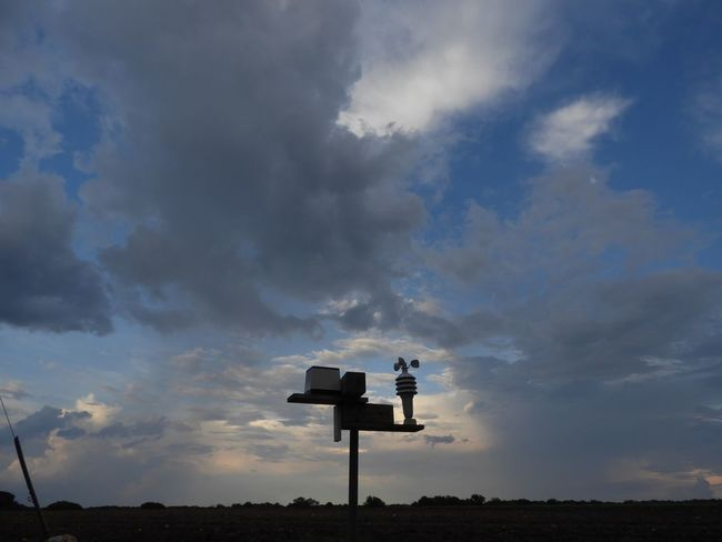 Weather station and a rainstorm Cloud - Sky Sky Silhouette Nature No People Communication Low Angle View Outdoors Technology Weather Vane Direction Sunset