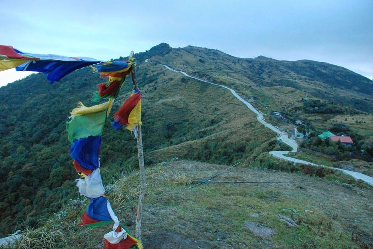 Multi colored praying flags against mountain