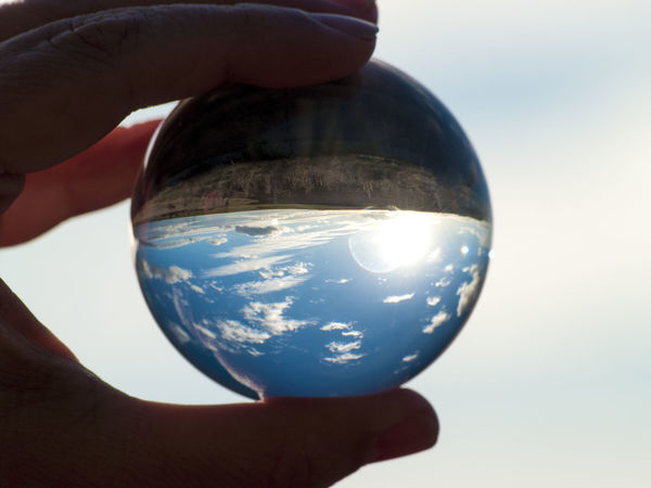 Crystal Ball EyeEm Best Shots EyeEm New Here Landscape_Collection Magnificent Nature Sphere Sphere Glass World In My Hands Ball Ball Reflection Concept Crystal Reflections Environment Hand Holding Human Body Part Human Hand Landscape Lifestyles Personal Perspective Real People Rural Scene Scenics Unrecognizable Person Shades Of Winter