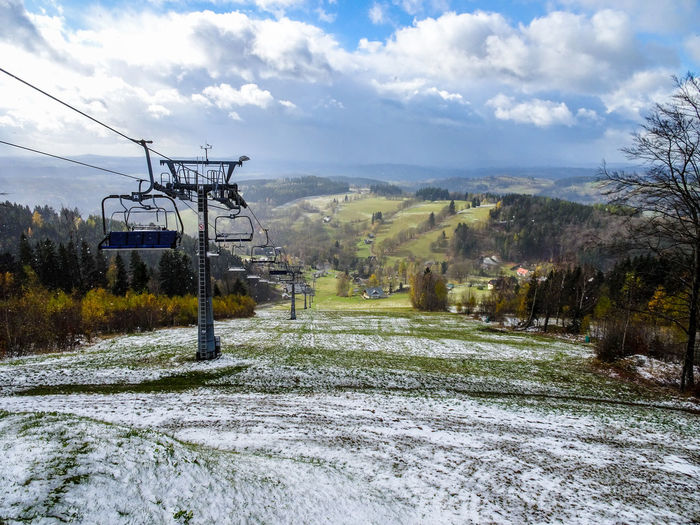 Ski Lift Beauty In Nature Cold Temperature Day Mountain Nature No People Outdoors Scenics Sky Snow Transportation Tree Winter