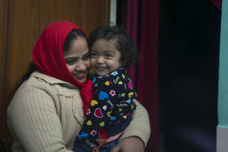 Happy mother and child at home