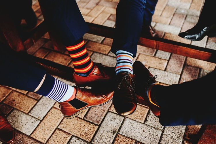 Low section of people showing socks