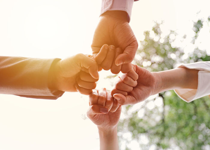 Business Teamwork Bonding Businesspeople Close-up Colleague Corporate Business Day Fist Bump Friendship Gift Giving Holding Human Body Part Human Hand Love Men Nature Outdoors People Real People Sky Togetherness Two People Women