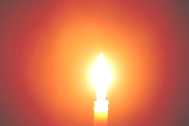 Bright Brightly Lit Burning Candle Close-up Copy Space Dark Fire Fire - Natural Phenomenon Flame Glowing Heat - Temperature Illuminated Indoors  Light - Natural Phenomenon Lighting Equipment Luminosity Nature No People Orange Color Red Studio Shot Yellow