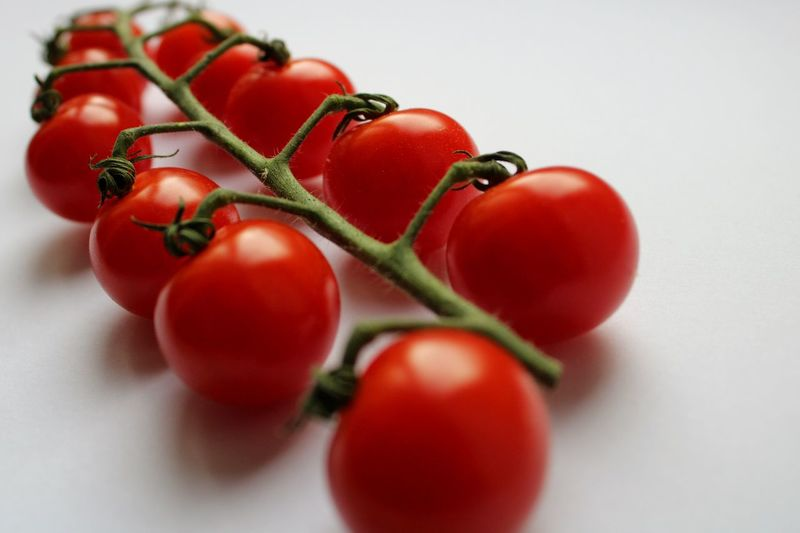Close-up of cherry tomatoes against white background