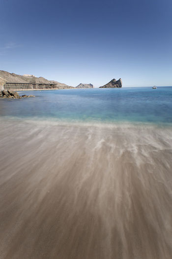 The Beach of the Cookers of the Hornillo, located in the Costa Cálida of the municipality of Águilas, province of Murcia, Spain. It is located along a small bay where at one end are the Yellow Beach and a small island called Isla del Fraile. Sea Scenics - Nature Beauty In Nature Sky Water Tranquility Land Tranquil Scene Beach Clear Sky No People Nature Day Mountain Sand Idyllic Blue Copy Space Outdoors Aguilas Murcia SPAIN Longexposure Colorful Landscape