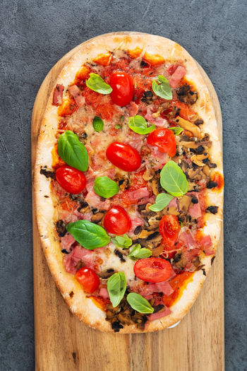 Directly above shot of pizza served on plate