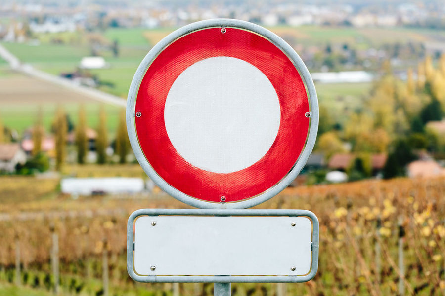 A road sign prohibiting traffic of all vehicles. Driving Sign Signal Transportation Car Circle Close-up Communication Day Europe Exclusion Focus On Foreground Law No People No Traffic Outdoors Prohibited Prohibition Red Road Sign Vehicle Warning Sign