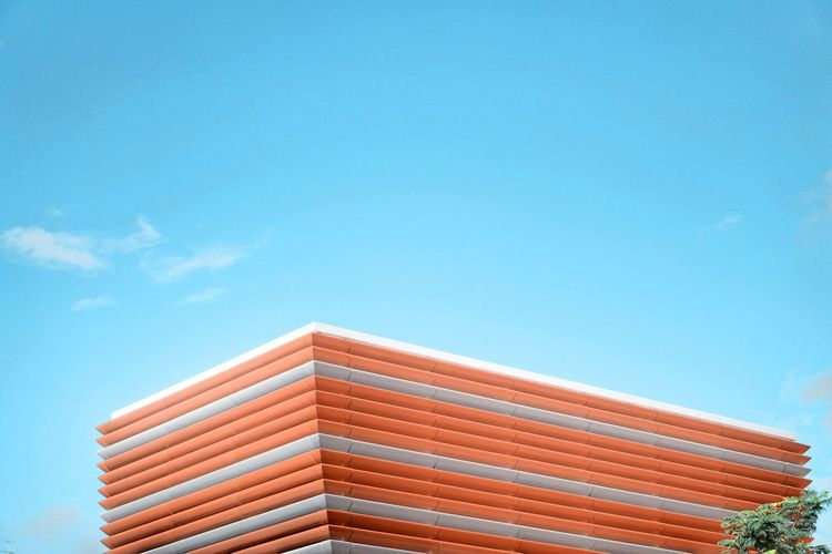 Sky Blue Architecture Built Structure Low Angle View Building Exterior Day Outdoors Modern Nature Clear Sky Multi Colored City Red Roof Sunlight Copy Space No People Building Pattern