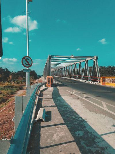Bridge over road against sky