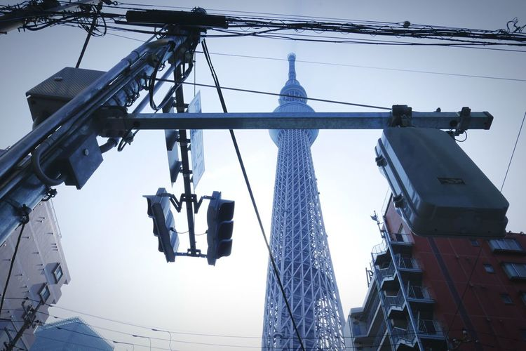Low Angle View Of Road Signal And Tokyo Sky Tree In City