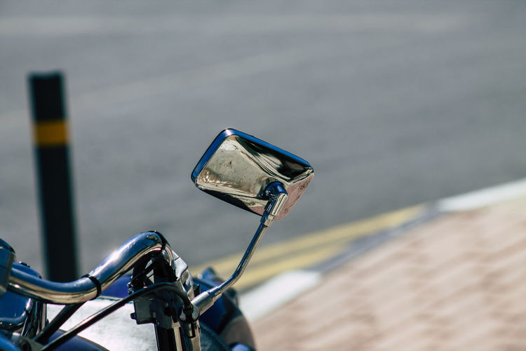 Close-up of motorcycle by road