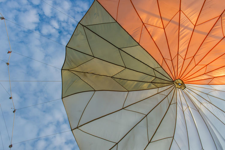 Low Angle View Sky No People Pattern Nature Mode Of Transportation Day Transportation Textile Outdoors Sailboat Cloud - Sky Hot Air Balloon Balloon Travel Canvas Nautical Vessel Close-up Sunlight Protection Directly Below