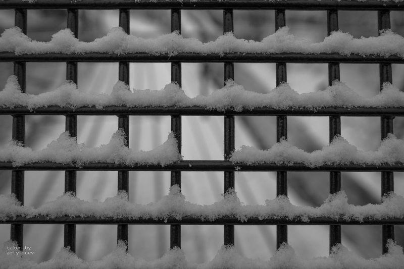 Full frame shot of snow on metal grate