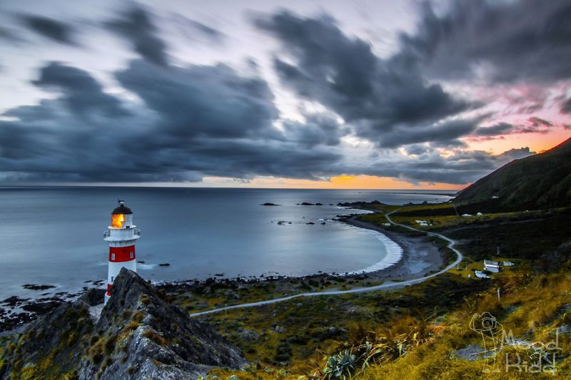 The southern-most tip on New Zealand's North Island, Cape Palliser. Water Tranquil Scene Scenics Sea Tranquility Non-urban Scene Beauty In Nature Cloud - Sky Sky Nature Cliff Travel Destinations Remote Outdoors Day Cloudy Storm Cloud Solitude Dramatic Sky Getting Away From It All Lighthouse No People Beauty In Nature Shore Coastline