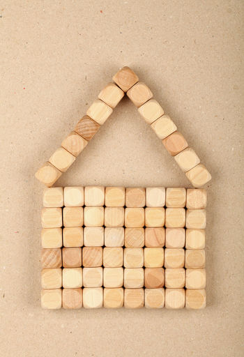 Directly Above Shot Of Wooden Blocks Arranged In House Shape