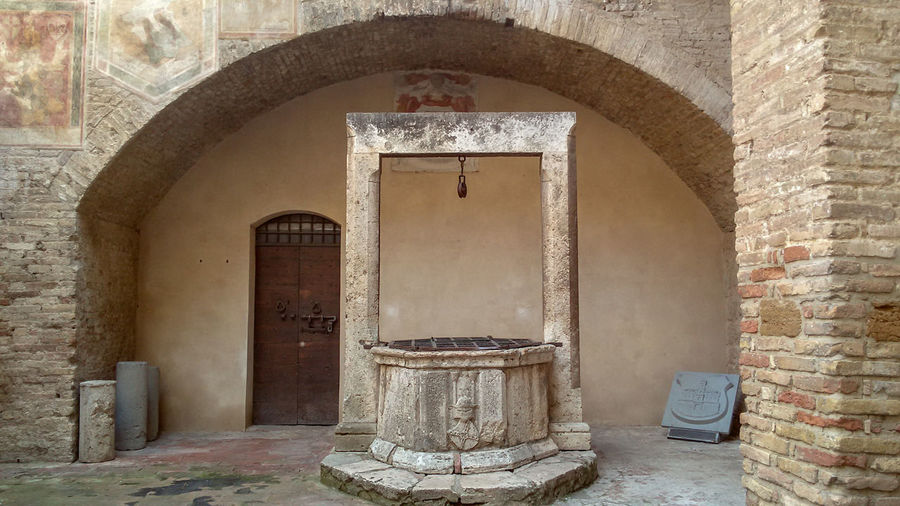 The wishing well San Gimignano Tuscany Italy Architecture And Art Historical Building Archeological Site Arch Door History Architecture Built Structure