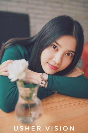 Real People Indoors  One Person Table Looking At Camera Black Hair Smiling Lifestyles Home Interior Portrait Childhood Close-up Flower Young Women Young Adult Day People Long Hair Nikon Beauty One Young Woman Only Beautiful Woman