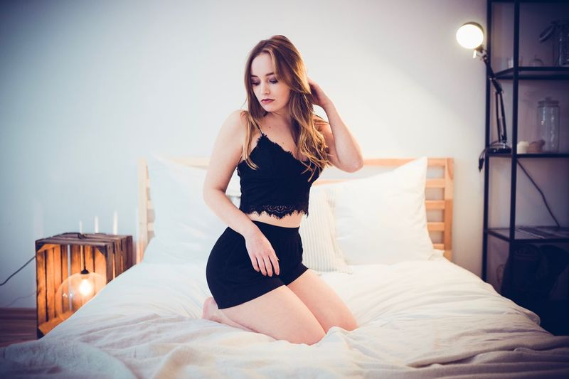 Relax. Dark Hair Girl Sitting Bed Bedroom Indoors  Young Women Young Adult Home Interior One Person Long Hair Full Length Lifestyles Pillow