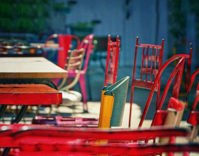 Close-up of red chairs