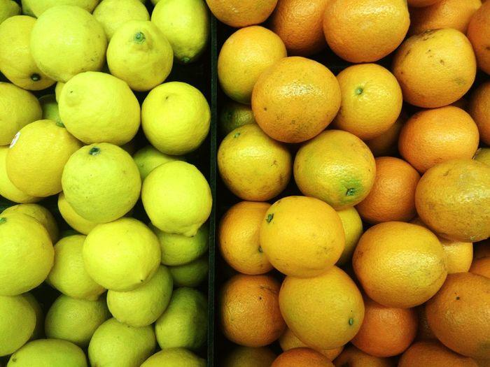 Full frame shot of oranges and lemons for sale at market stall