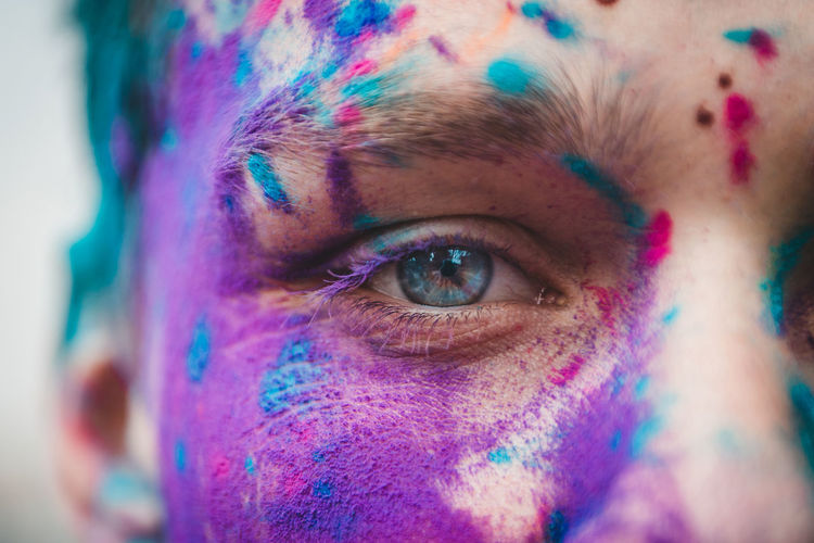 Adult Body Part Celebration Close-up Eye Eyesight Face Paint Festival Headshot Holi Human Body Part Human Eye Human Face Looking At Camera Multi Colored One Person Paint Portrait Real People Teenager Young Adult