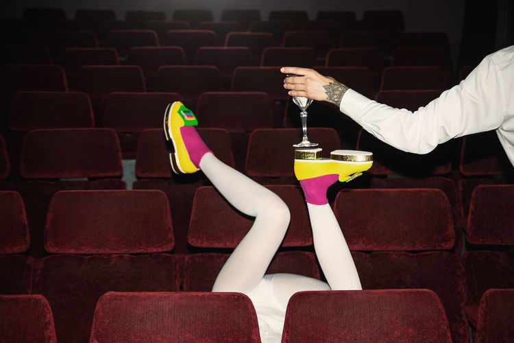 Merci! Cinema Theater Red Chairs Pink Socks Yellow Shoes Shoes Fashion Garçon Waiter Glass Of Milk Fashionista Women Fashion Avant-garde  Linas Was Here