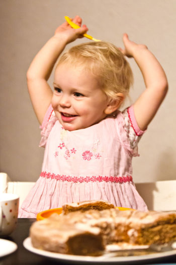 Girl Standing By Food On Table