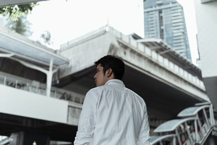 Low angle view of businessman standing in city