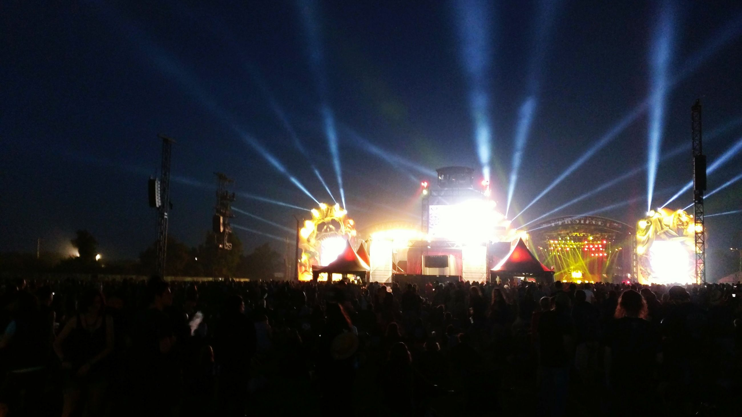 illuminated, night, large group of people, crowd, person, arts culture and entertainment, event, lighting equipment, nightlife, celebration, music, enjoyment, performance, music festival, stage - performance space, concert, lifestyles, light - natural phenomenon, stage light