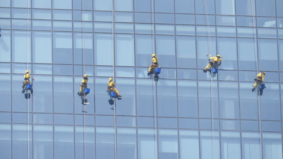 Window washers on modern building