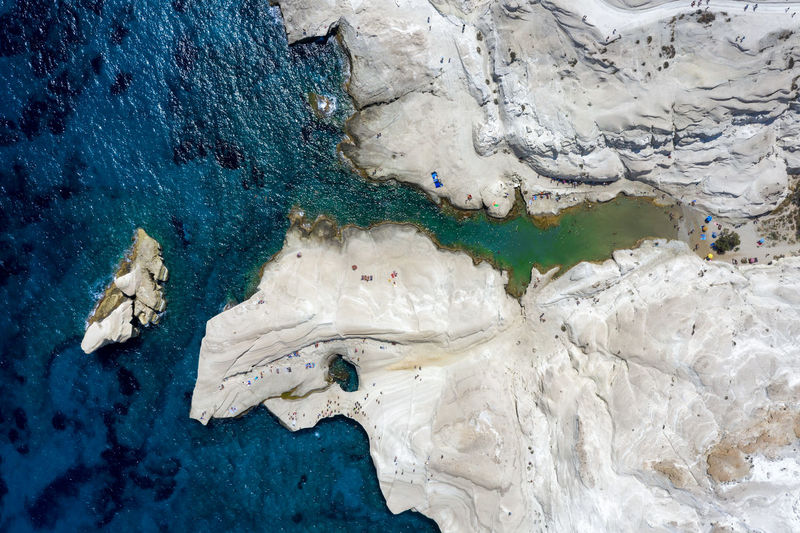 High angle view of blue sea and rock