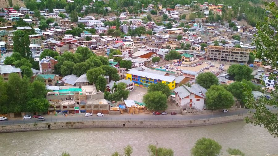 High angle view of townscape by road in city