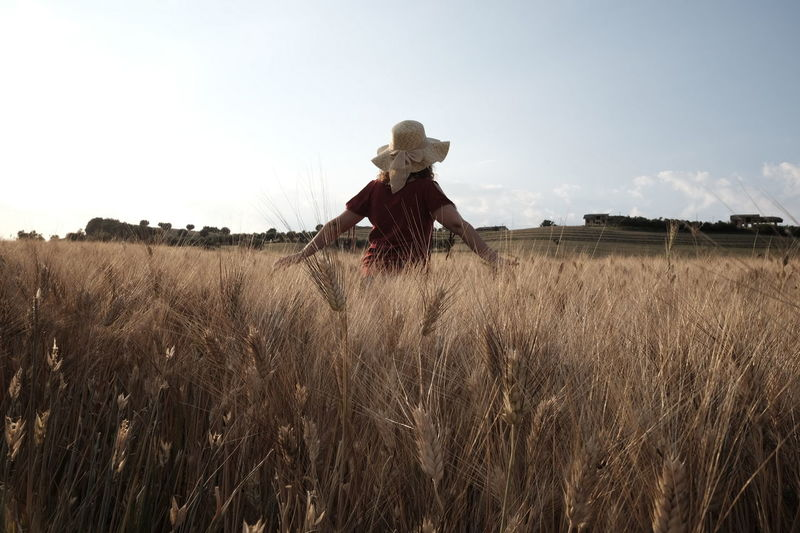 Adult Adults Only Agriculture Cowboy Hat Day Field Full Length Growth Low Angle View Nature One Person One Woman Only Only Women Outdoors People Rural Scene Sky Standing Wheat Wheat Field Young Adult