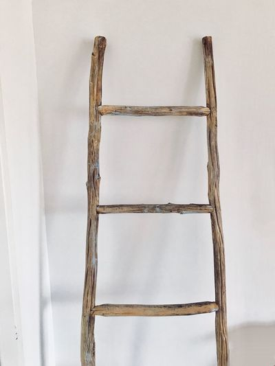 Step ladder Indoors  White Color Wall - Building Feature No People Old Pattern Built Structure Architecture Close-up Wood - Material Single Object Empty Ladder Frame Copy Space Still Life Studio Shot Equipment Backgrounds