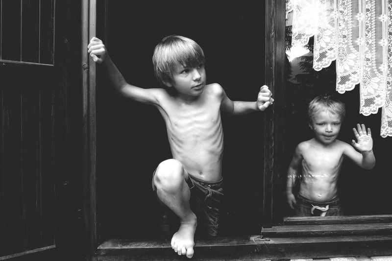Portrait Of Boys In Window