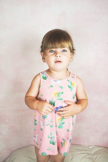 Girl Child Today's Hot Look Funny Childhood Family Kid Kids Blond Hair Blue Eyes Studio Shot Portrait Model People Portraiture Cute Lovely Pink Color Females Emotion Expression Beautiful Beauty In Nature Pretty