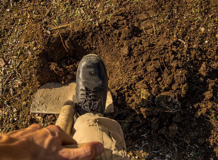 Digging a hole with shovel and black boots in the field. Agriculture Boots Field Man Planting Work Working Body Part Casual Clothing Day Digging Hole Human Body Part Human Leg Job Land Lifestyles Men Nature Outdoors People Personal Perspective Real People Shovel Tools